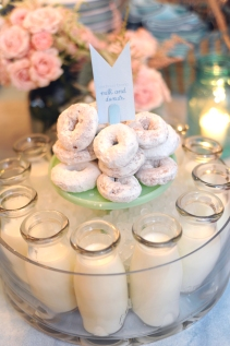 Krispy Creme powdered sugar donuts with milk (bottles from West Elm)