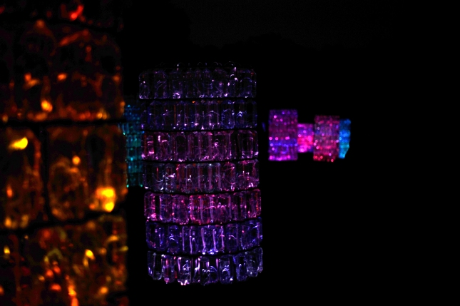 Water-Towers: Comprised of 40 structures built out of one-liter recyclable plastic bottles filled with water and optical fibers connected to an LED projector and audio system.